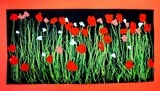 Field of Poppies: Kindergarteners used different shades of green oil pastels to add the grass and stems, and then used small, medium, and large brushes to paint their poppies.
