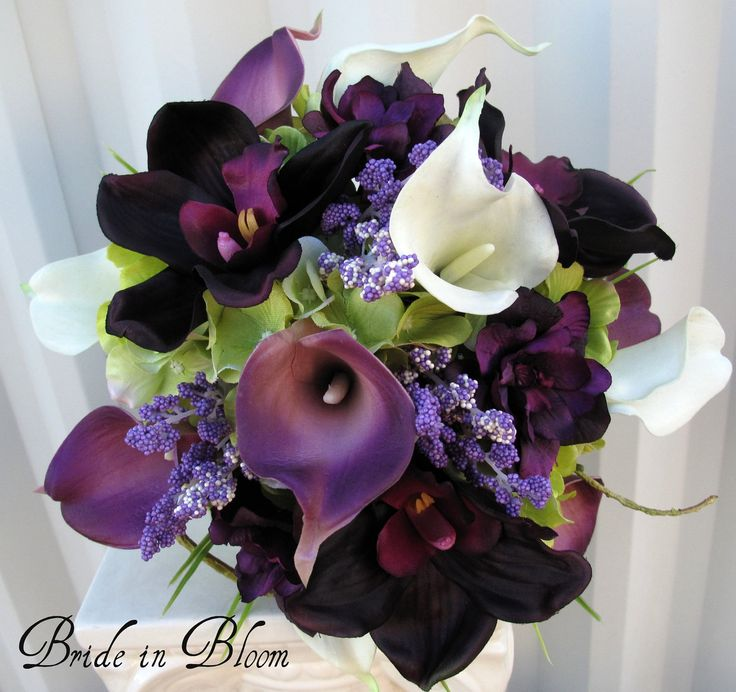 Brides bouquet real touch calla lily plum orchid.