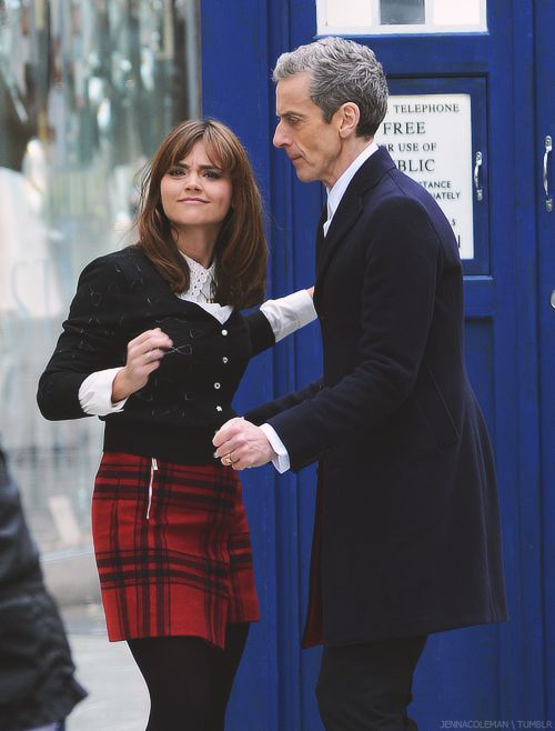 Peter Capaldi & Jenna Louise Coleman filming Doctor Who. This picture looks like they're in the middle of a really awkward dance.