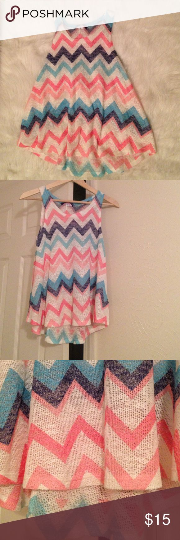 High low chevron top. NWOT. Chevron top has never been worn . In excellent condition . No trades. 0093 Tops Tank Tops