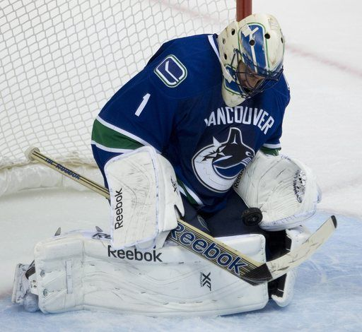Vancouver Canucks goalie Roberto Luongo makes a save during the second period of NHL pre-season hockey action against the New York Rangers September 26, 2013  |  New York's Alain Vigneault and Vancouver's John Tortorella coached against their former teams for the first time.