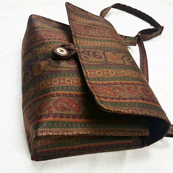 Check out this item in my Etsy shop https://www.etsy.com/listing/219459997/handmade-brown-paisley-fabric-messenger