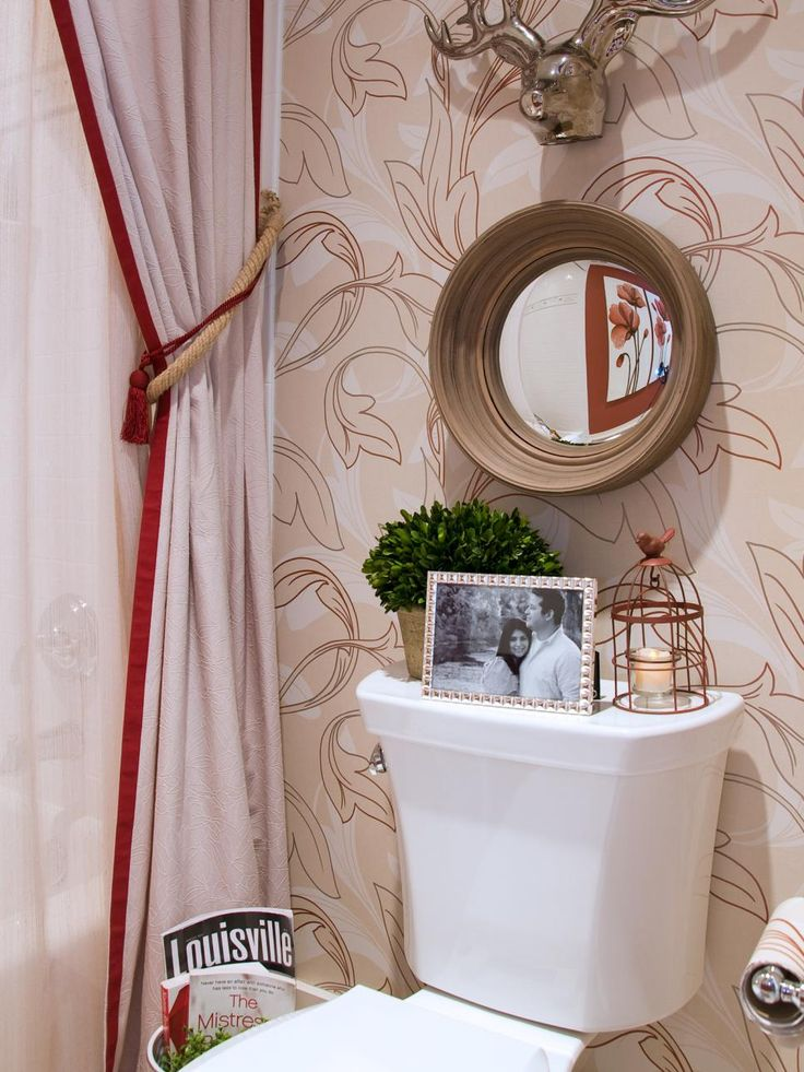 The Art Gallery Check out this elegant traditional bathroom design featuring red and white floral wallpaper and unique accessories