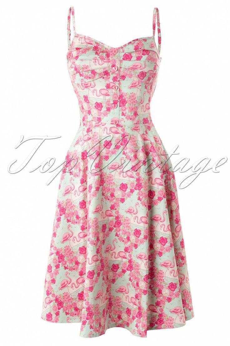 Nieuwe Collectif collectie ~ De Fairy Flamingo Dress Blue and Pinkis een vrolijke zomer jurk met een prachtige kleurige flamingo print. De top is geplooid, heeft met stof gevoerde cups en schattige roze hartjes knoopjes. Verstelbare spaghetti bandjes en aan de achterzijde voorzien van elastisch smock voor een perfecte pasvorm met wijder uitlopende rok - te dragen zonder petticoat - en uitgevoerd in een katoen met een fijne stretch. Geen rits, je trekt hem over je hoofd aan...