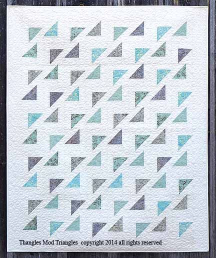 "Mod Triangles quilt - Mod Triangles is a fast and fun project that can be made with charm squares or strips. It is one simple block. Make a lap (47"" x 57"") or a queen (86"" x 92"") For the lap version you need 40---5"" charms and 2 5/8 yds of background and binding fabric. In place of the charms you can use 5---4"" x 45"" strips of 5 different fabrics. That is how we made our sample. The queen version uses 91---5"" charms or 12---4"" x 45"" strips of fabric and 7 1/4 yds of background and bindin"