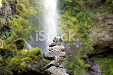 Stone Cairn with distant Waterfall Royalty Free Stock Photo