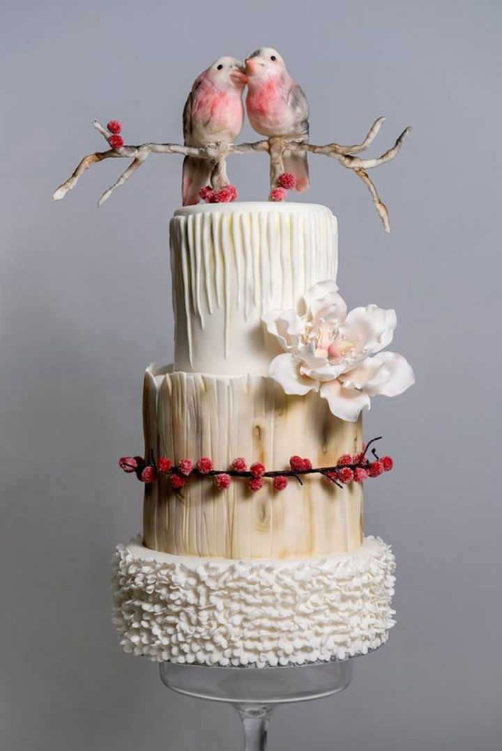 Gorgeous textured wedding cake.  Love the berries and the love birds