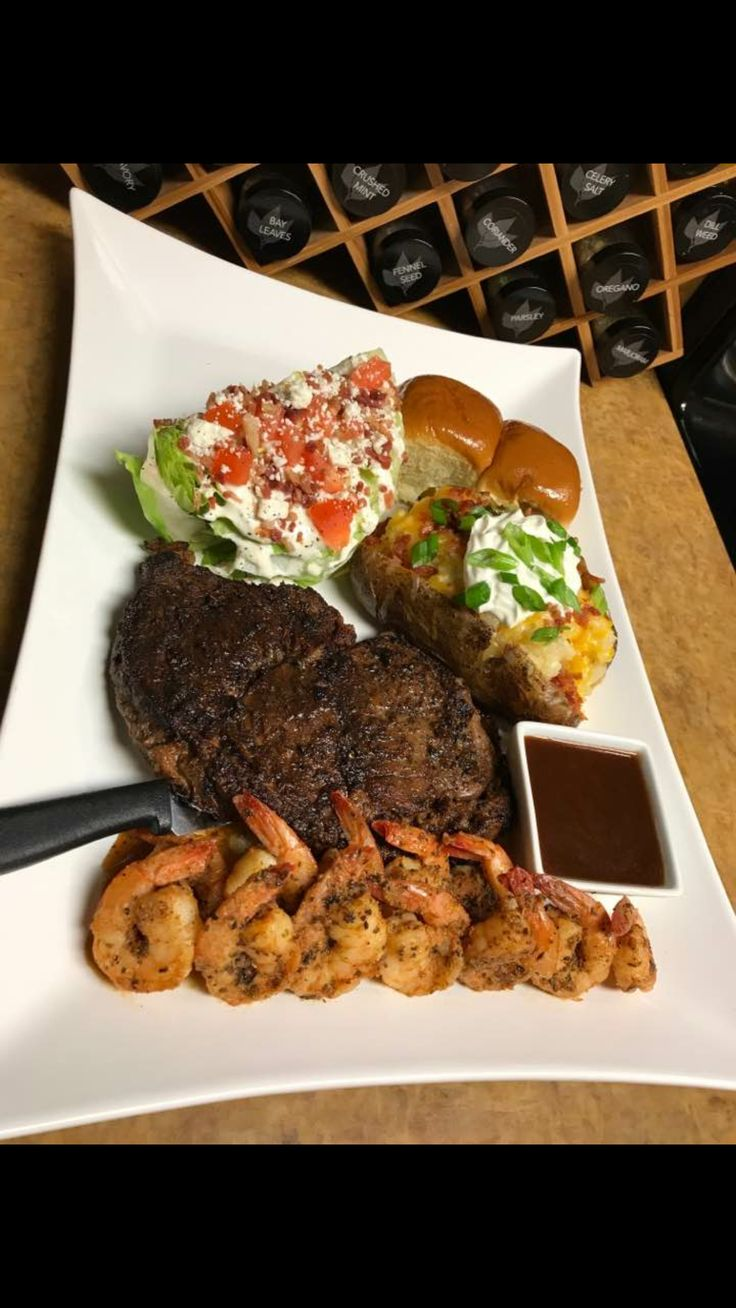 Surf and Turf with loaded baked potato, classic wedge of lettuce and homemade dinner rolls. Bon Appetite.