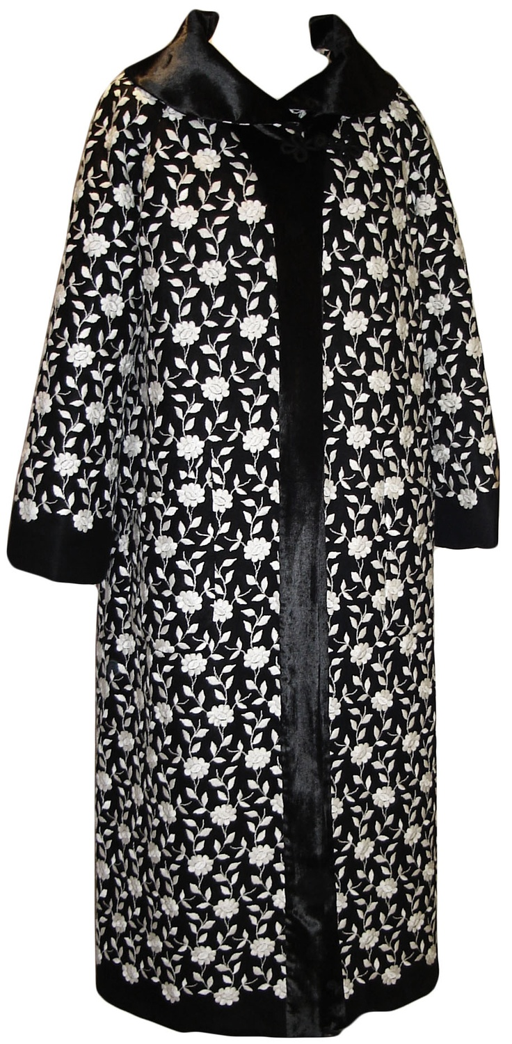 Vintage Erte Coat in black linen with embroidered white flowers.  Coat has crystal velvet collar, cuffs and front facing.