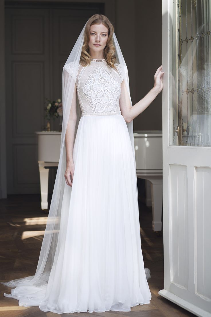 Divine Atelier wedding dress with cap sleeves.