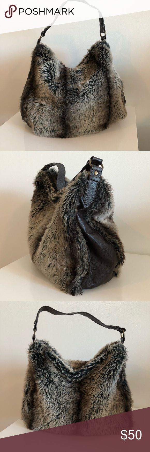 Faux fur and brown handbag Faux fur handbag with dark brown trim and a single shoulder strap. Inside brown fabric lining with a zip up pocket and 2 small cellphone pockets. Marks & Spencer Bags Shoulder Bags