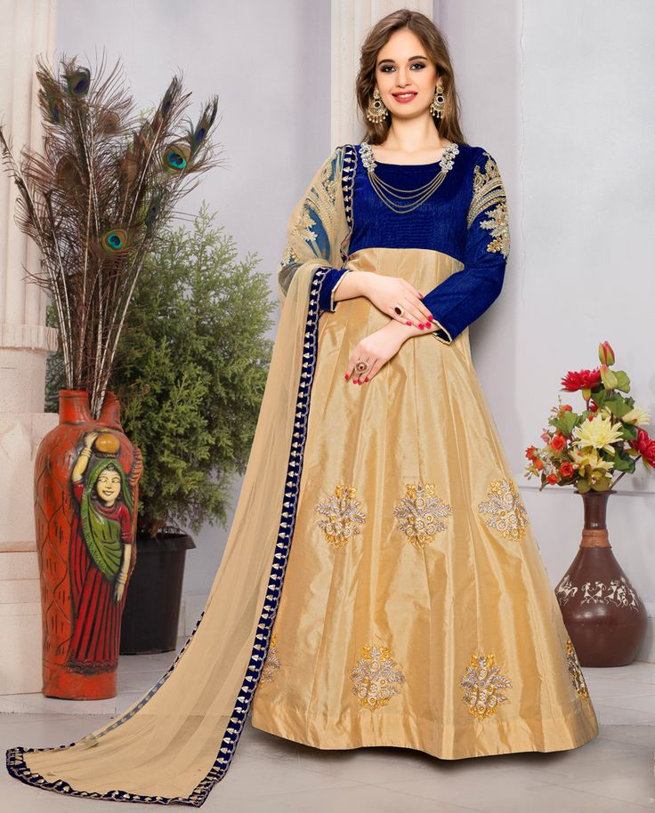 1. Blue and beige taffeta silk suit 2. Heavy embroidery work on sleeve and floral 3. Comes with a matching santoon bottom and net dupatta 4. Jewellery is part of shooting not comes with dress 5. Can be stitched upto size 42 inches