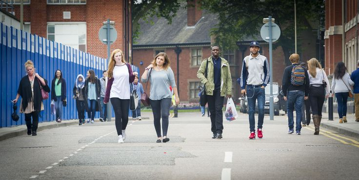 First year students walk past DMU's campus transformation project.