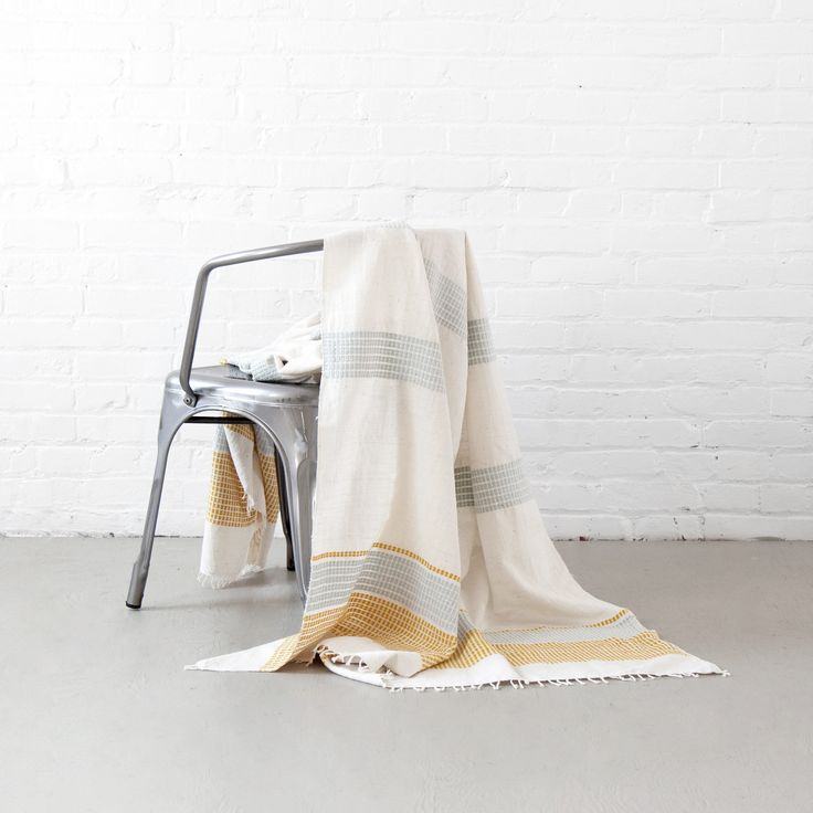 These beautiful lightweight cotton blankets have been hand spun and woven by talented Ethiopian artisans.  By Creative Women www.etico.co.nz