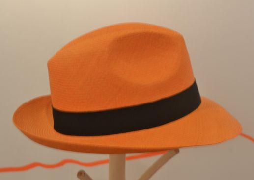 Beautiful orange hat made from iraca palm tree!