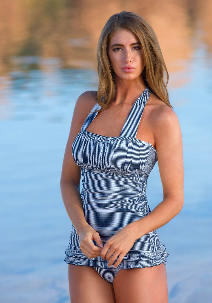 Offers a slimming shape with shirring along the bodice that helps conceal and provide a flattering figure. Vertical chest gathering provide the illusion of added fullness. Double ruffles and back tie