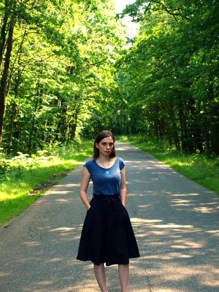 blue tee and black skirt