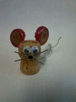A mouse I made from a wine cork, two beer bottle caps, two paper clips, and googly eyes.