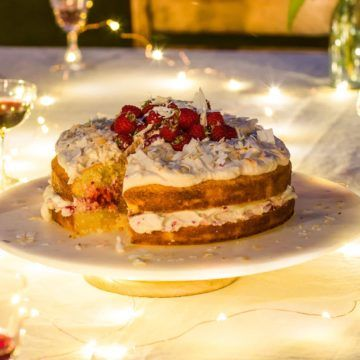 Lime and coconut cake with white chocolate cream and raspberries