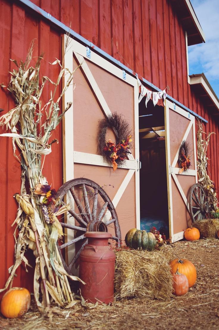 Old wagon wheels and cornstalks outside the barn doors.