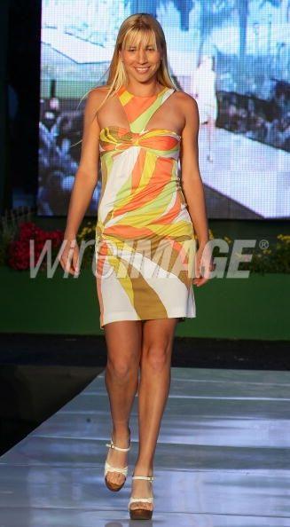 Tennis player Alyona Bondarenko walks...