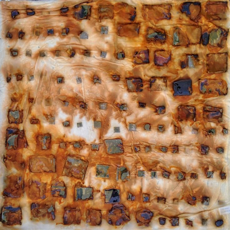 This silk pillow case is being rust dyed with metal fragments. Click for the tutorial.