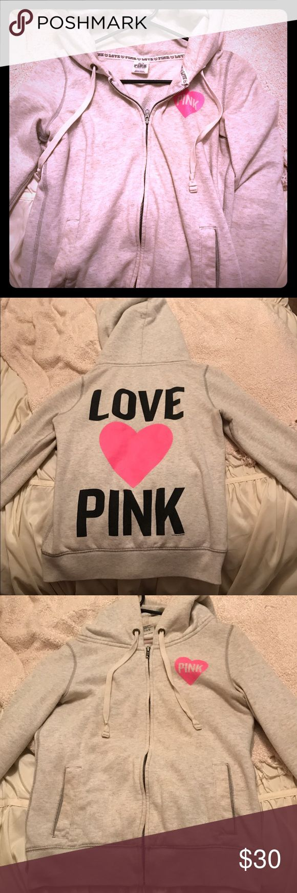 Victoria's Secret 'pink' zip up hoodie Victoria's Secret 'pink' zip up hoodie in good used condition. Color is light grey and it's an extra small, although I wear a small and this fits fine. Has been worn and washed several times but is in great condition with no stains or damage. PINK Victoria's Secret Tops Sweatshirts & Hoodies