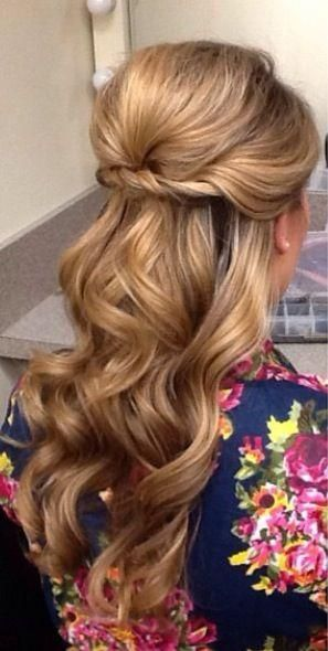 Long Soft curl pulled back with twisted hair
