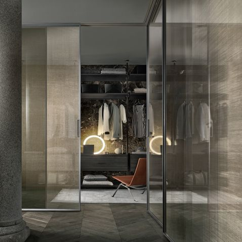 Zenit walk-in closet with brown aluminum uprights and coal larch melamine accessories.