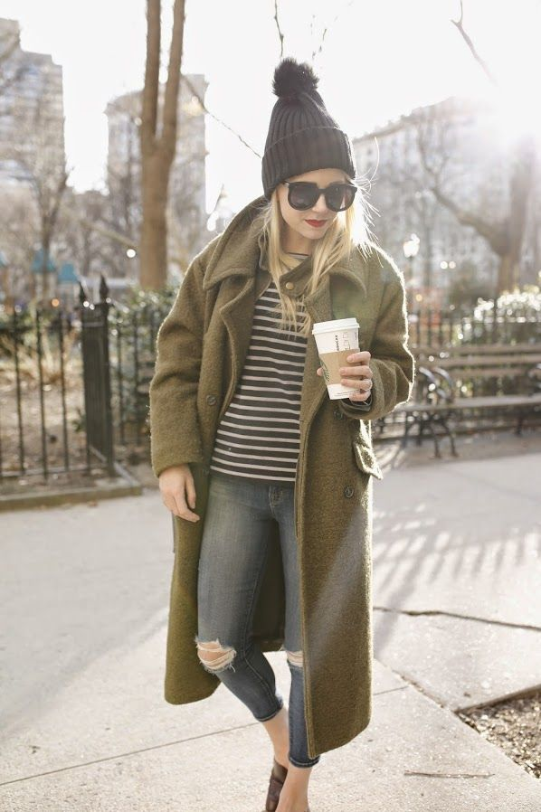Long green coat + black knit bobble beanie + ripped skinny jeans + black and white striped top