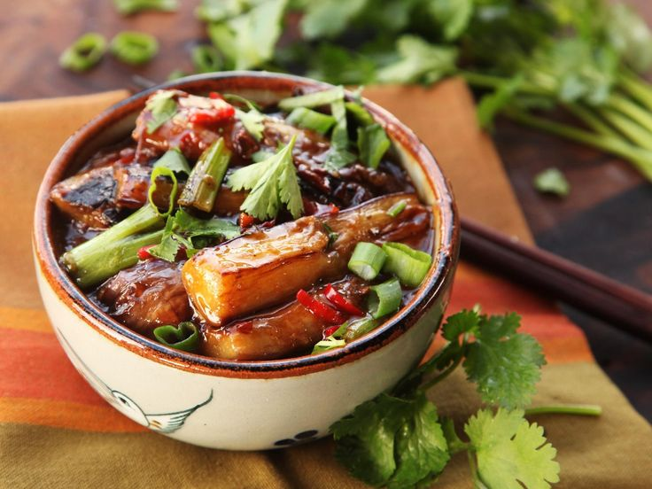 """Despite its translation—""""fish fragrant eggplant,""""—yu xiang qie zi actually contains no seafood or meat products whatsoever. It gets its name from the combination of hot, sour, and sweet flavors that are typically served with fish in its native Sichuan. Smoky eggplant is stir-fried until tender, then tossed with a quick sauce flavored with chilies, black vinegar, sugar, and ginger, and garlic for a hearty, flavor-packed dish that comes together in one wok with minimal effort."""