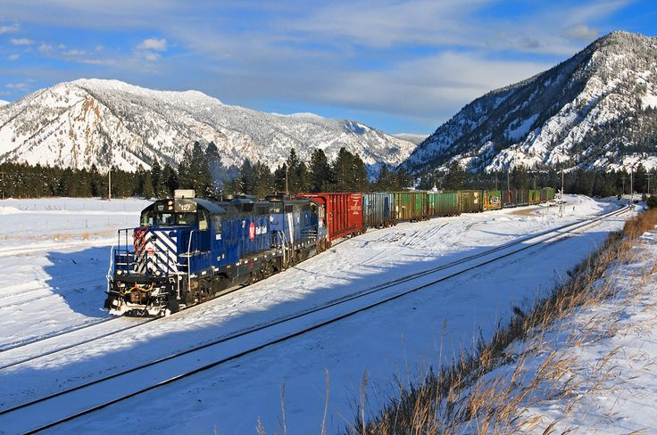 https://flic.kr/p/BTWzEE | Winter at Woodlin | Montana Rail Link's Paradise Local backs up the Thompson River Lumber Lead at Woodlin near Thompson Falls, Montana, on a cold, crisp February 7, 2014. Recently-repainted EMD GP9 No. 127 leads the train, which will return to Paradise after switching three customers on the spur.