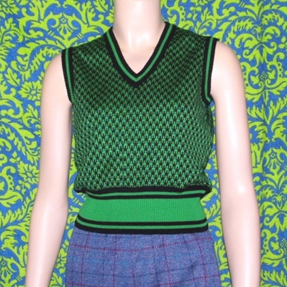 Buy only vintage clothes.  70s sweater vest