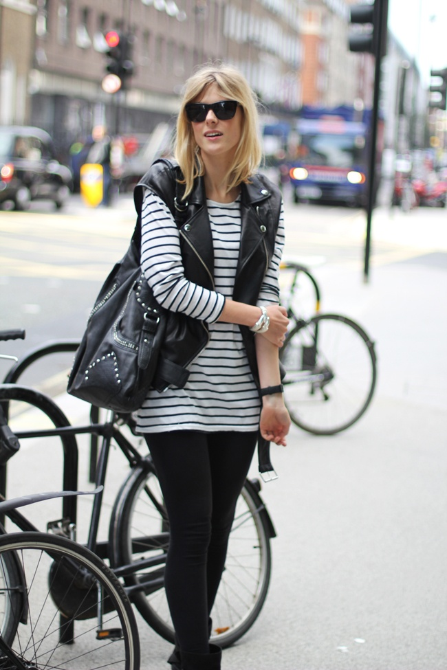 black leather vest ... paired w/ long, long-sleeved shirt & tights