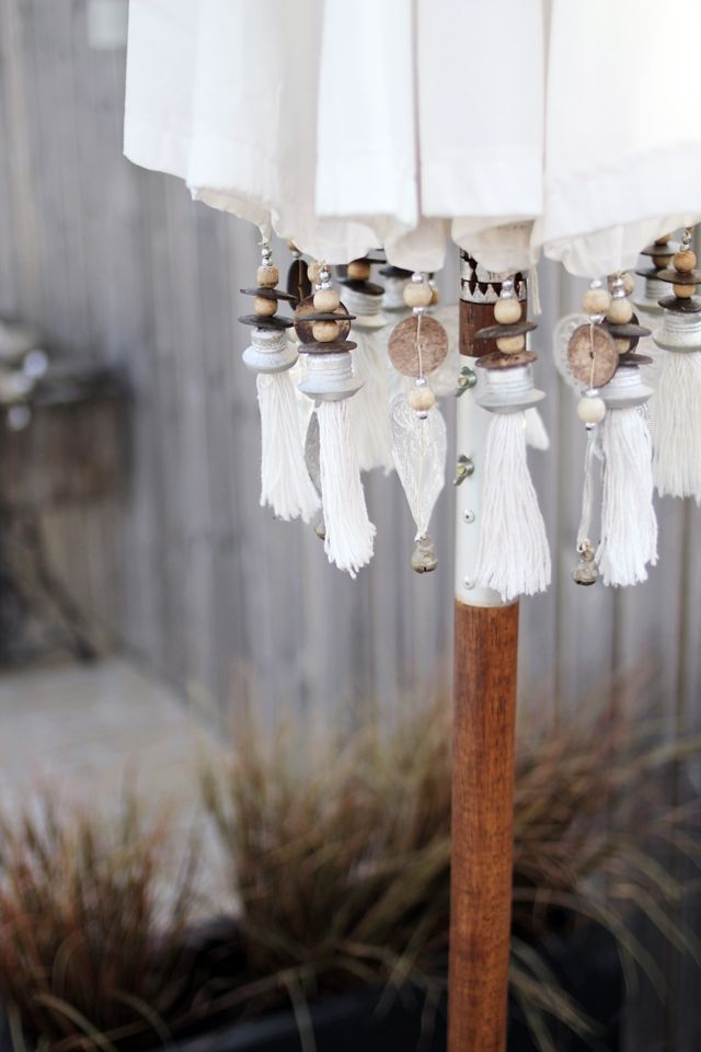 Fringe, beads, and charms edge a a festive Balinese Garden Umbrella