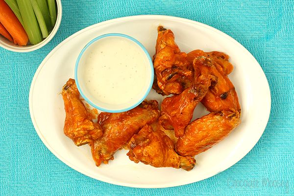 Baked Buffalo Chicken Wings tossed in an easy sauce of hot sauce and melted butter will be finger lickin' good (and save you money on take out). Buffalo wings and I go way back. So far back that I ...