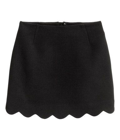Black. Short skirt in woven fabric with a visible zip at back and a scalloped hem. Lined.
