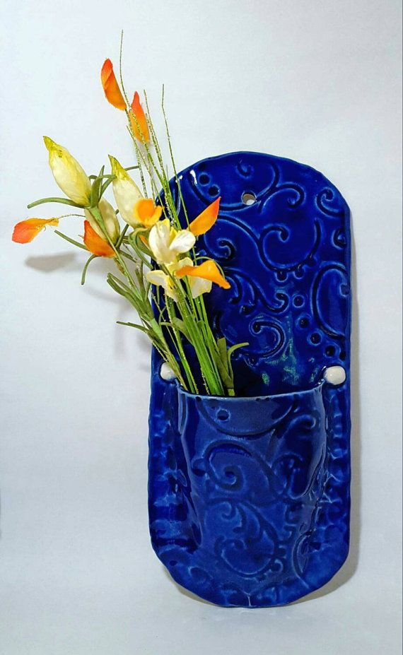 Hey, I found this really awesome Etsy listing at https://www.etsy.com/listing/223373095/blue-ceramic-wall-pocket-clay-wall-art