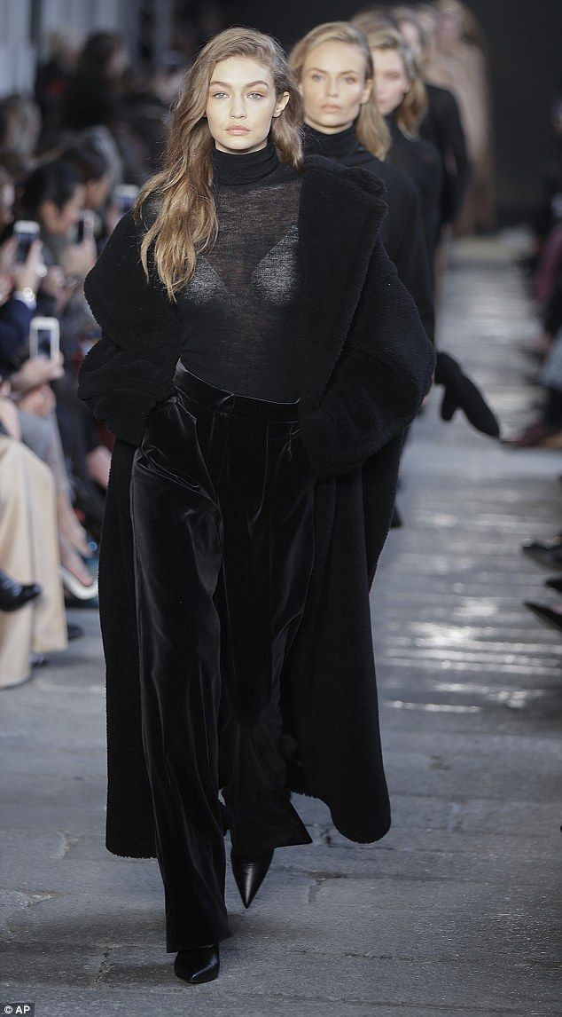 Sheer delight: Gigi Hadid sported a semi see-through black polo neck as she strutted her stuff at the Max Mara