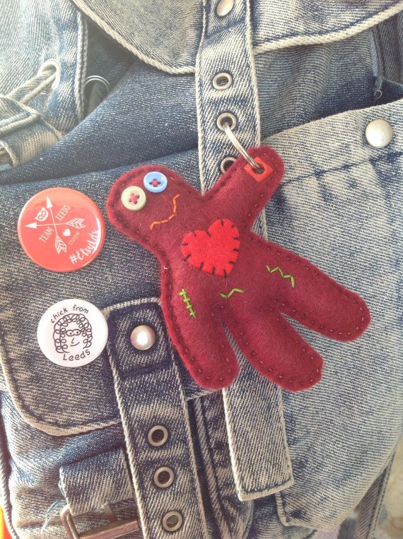 This is a hand sewn felt keyring in the shape of a zombie. His name is Jacob and he enjoys holding keys or hanging out on bags. Dont worry, Jacob is now fully vegetarian so no brains are required. This item measures approximately 11 cm x 9cm. The little zombie has an appliqué heart, button eyes and embroidered scars. His hand is reinforced with a brad and a split ring supplied. Jacob is stuffed with 100% Hi-loft polyester which is child friendly, although please note this item is not…