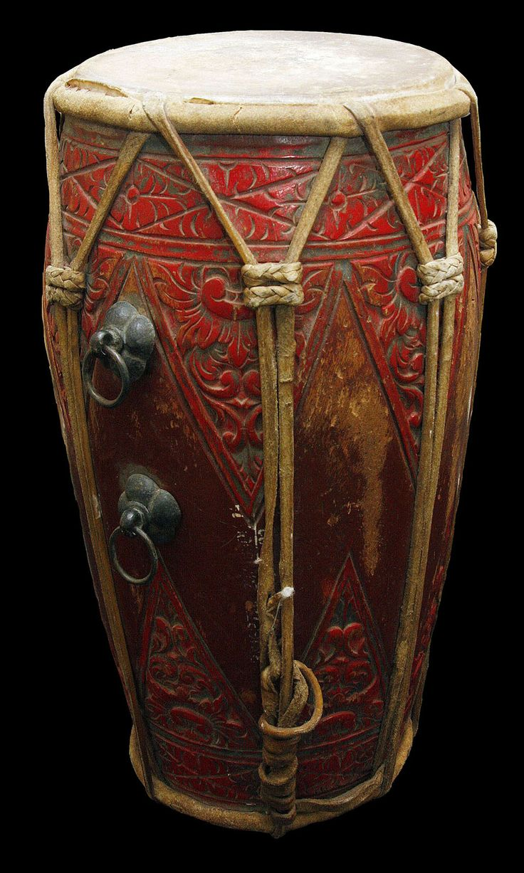 Javanese Gamelun Drum. There are several drums or kendhang of different sizes in a Javanese gamelan ensemble. The laces drum, made with skin heads on both sides, may be played by a drummer, one or two at a time. The instrument supplies direction to the rest of the musicians and has a wide variety of sounds. Location: Indonesia   Circa Date: Early 20th Century.