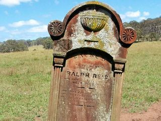 AT FIRST SIGHT: The headstone of pioneer Ralph Reid on the banks of Acacia Creek when Lyn Spain first found it in 2008.