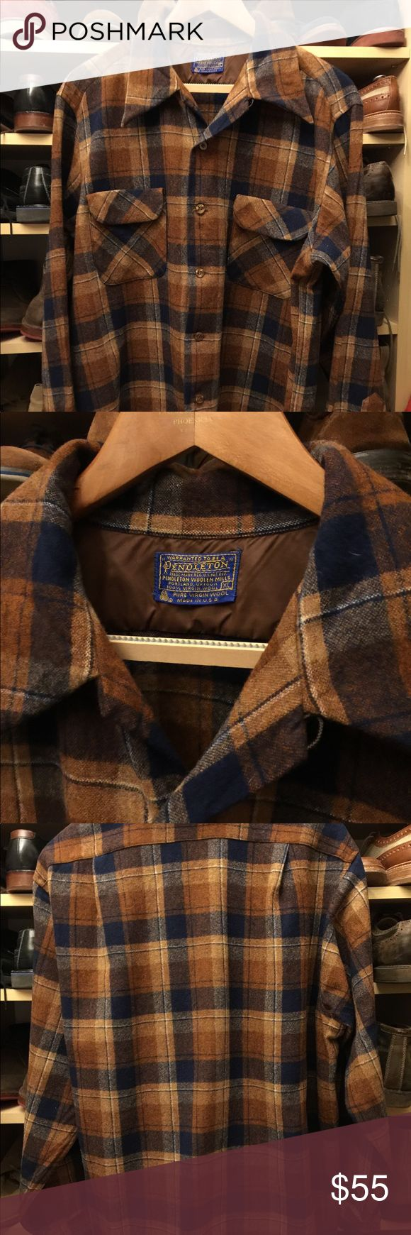 Vintage Pendleton shirt Original Pendleton 100% virgin wool plaid shirt in brand new condition. It was never worn. It has 2 front pockets. It is a gorgeous caramel and navy blue plaid that goes well with jeans or caqui. Pendleton Shirts Casual Button Down Shirts