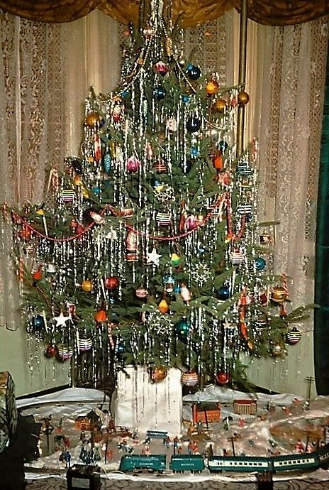 Typical 1950s Christmas tree w. train set in 2020