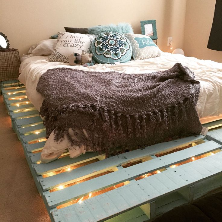 Super cute aqua blue pallet bed with twinkle lights :))