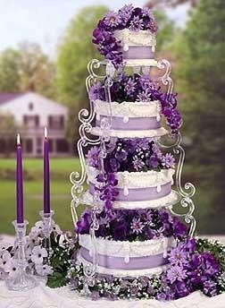 Purple wedding cake; a bit overdecorated for my taste, but it's well done.   ᘡղbᘠ