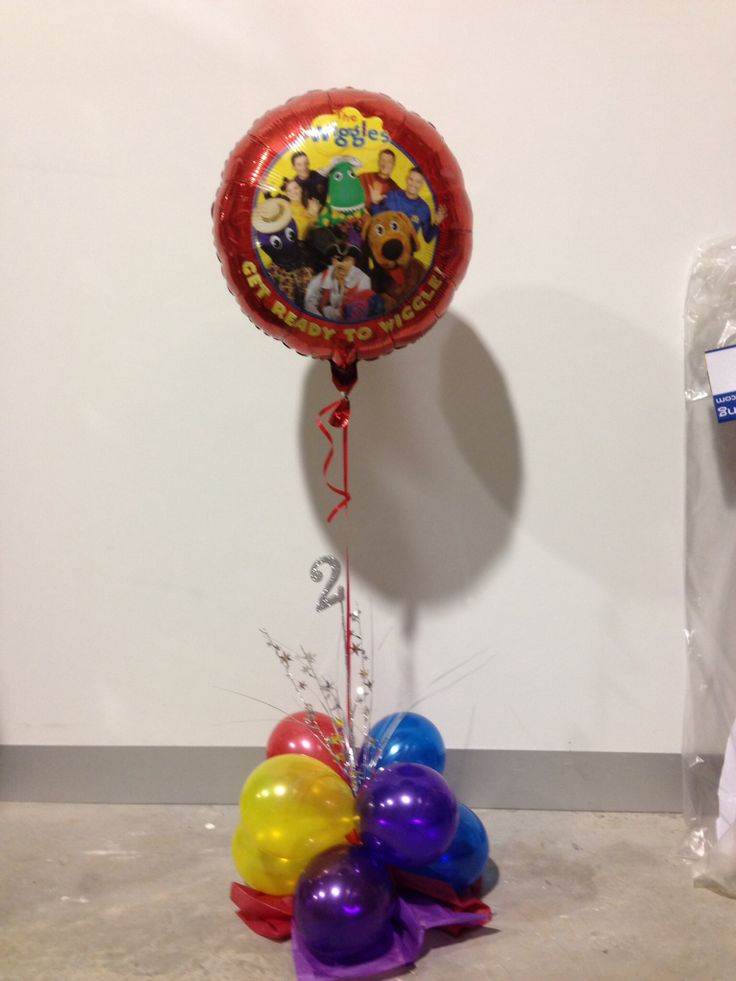 The wiggles foil balloon table decoration for a 2nd birthday party. Made by Let's Celebrate Parties