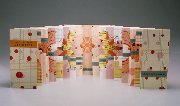 Ode to a Grand Staircase.  Julie Chen's colorful and ingenious display of paper engineering.