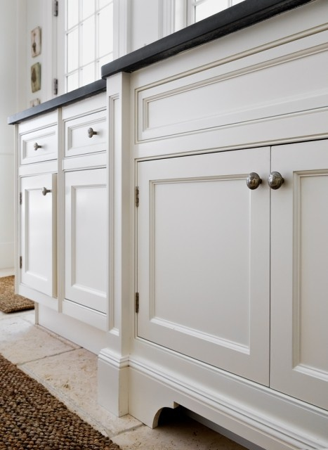 add moulding base to cabinets