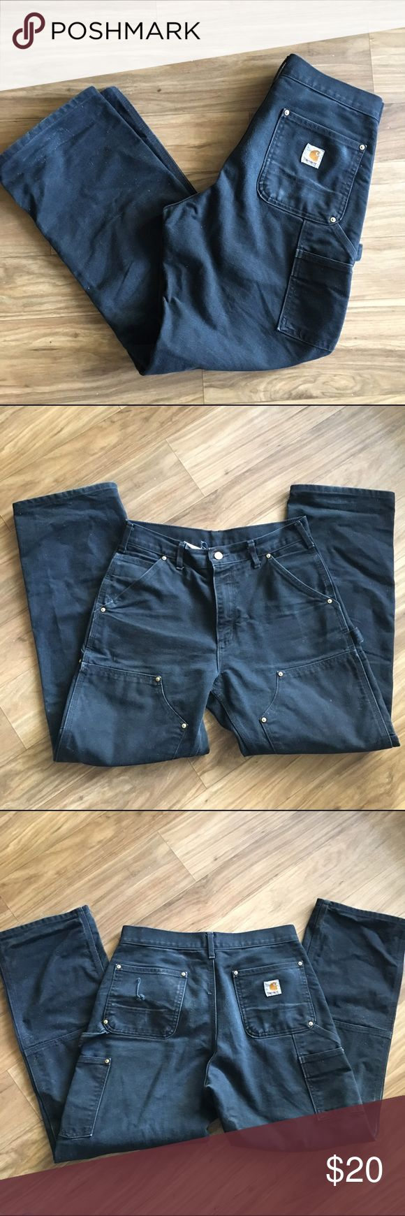 Carhartt work pants Faded black because my boyfriend used them for work but still have a ton of life left. Thick heavy denim. Small hole in back pocket. Original fit. Carhartt Jeans